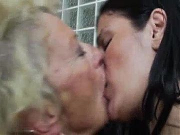 Granny and young girl lesbian naked in a crazy kiss